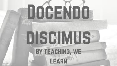 Docendo discimus.png